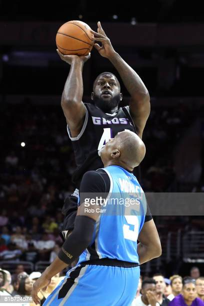 Ivan Johnson of the Ghost Ballers shoots against Cuttino Mobley of Power during week four of the BIG3 three on three basketball league at Wells Fargo...
