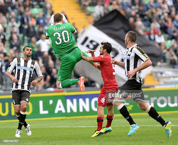 Ivan Kelava goalkeeper makes a save next to Maurizio Pinilla of Cagliari during the Serie A match between Udinese Calcio and Cagliari Calcio at...