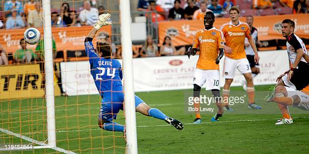 Ivan Klasnic of Bolton shoots past goalkeeper Tyler Deric of the Houston Dynamo for a goal in the first half at Robertson Stadium on July 20 2011 in...