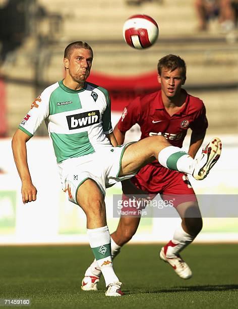 Ivan Klasnic of Bremen controlsthe ball as Pascal Bieler of Essen defends during the friendly match between Rot Weiss Essen and Werder Bremen at the...