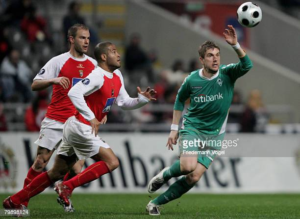 Ivan Klasnic of Bremen fights for the ball with Rodriguez and Paulo Jorge of Braga during the UEFA Cup round of 32 second leg match between SC Braga...