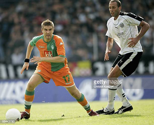 Ivan Klasnic of Bremen runs with the ball as Pellegrino Matarazzo of Wattenscheid follows him during the DFB German Cup match between SG Wattenscheid...