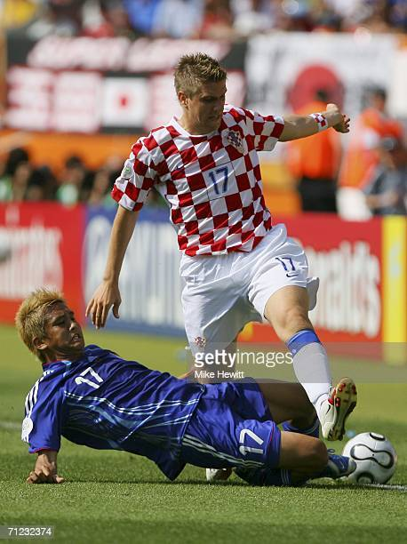 Ivan Klasnic of Croatia is tackled by Junichi Inamoto of Japan during the FIFA World Cup Germany 2006 Group F match between Japan and Croatia at the...