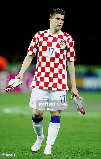 Ivan Klasnic of Croatia removes his boots at the end of the FIFA World Cup Germany 2006 Group F match between Brazil and Croatia played at the...