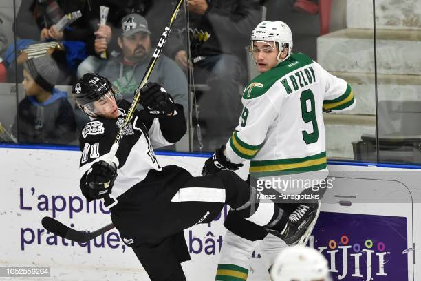 Ivan Kozlov of the ValdOr Foreurs checks Simon Lavigne of the BlainvilleBoisbriand Armada during the QMJHL game at Centre d'Excellence Sports...