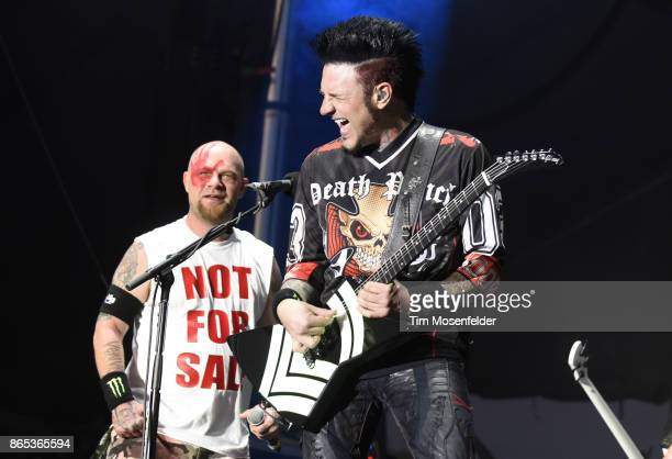 Ivan L Moody and Jason Hook of Five Finger Death Punch perform during the Monster Energy Aftershock Festival at Discovery Park on October 22 2017 in...