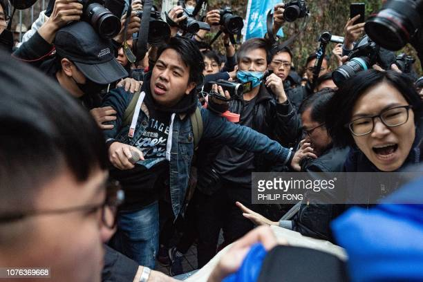Ivan Lam the chairman of prodemocratic party Demosisto chants the slogan as a group of protesters and security guards clash outside the government...