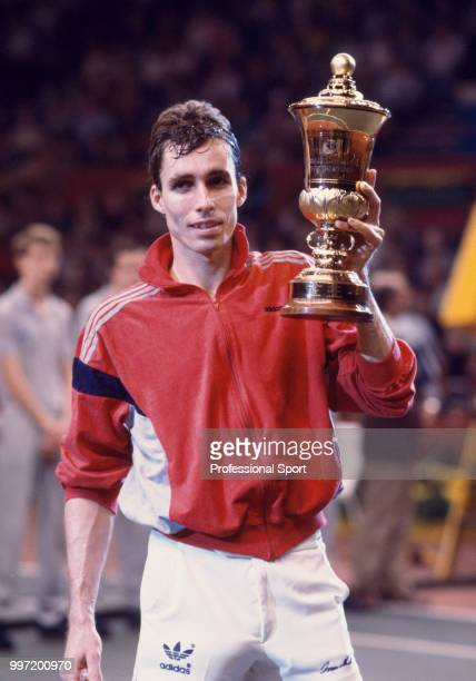 Ivan Lendl of Czechoslovakia lifts the trophy after defeating Andres Gomez of Ecuador in the Singles Final of the Benson Hedges Tennis Championships...