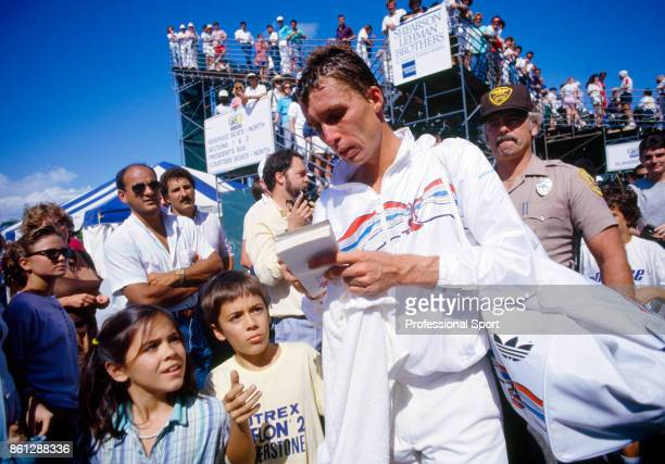 Ivan Lendl of Czechoslovakia signs autographs after a match during the Lipton International Players Championships at the Tennis Center at Crandon...