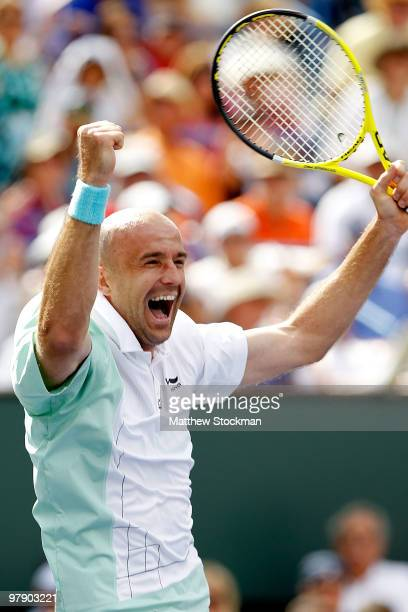 Ivan Ljubicic of Croatia celebrates match point against Rafael Nadal of Spain during the semifinals of the BNP Paribas Open on March 20 2010 at the...