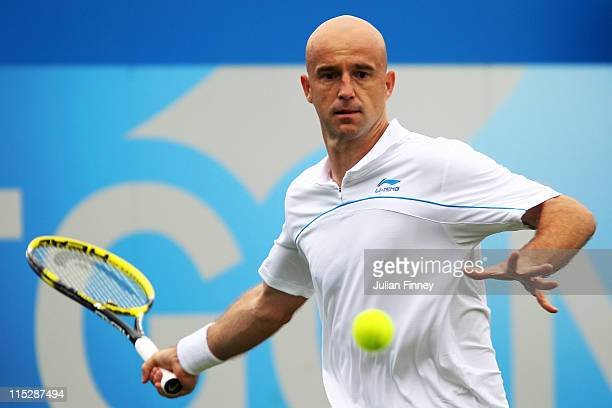 Ivan Ljubicic of Croatia eyes the ball during his Men's Singles first round match against Ryan Sweeting of the United States on day one of the AEGON...