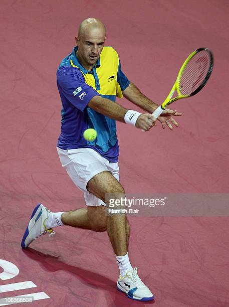 Ivan Ljubicic of Croatia plays a backhand during his semi final match against Albert Montanes of Spain during day six of the Open Sud de France at...