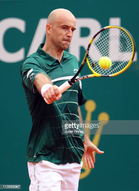 Ivan Ljubicic of Croatia plays a backhand in his match against Jo-Wilfried Tsonga of France during Day Three of the ATP Masters Series Tennis at the...