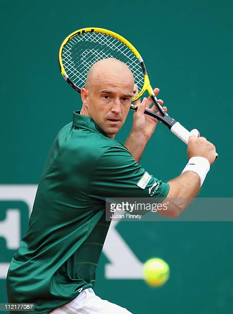 Ivan Ljubicic of Croatia plays a backhand in his match against Tomas Berdych of Czech Republic in action against during Day Five of the ATP Masters...