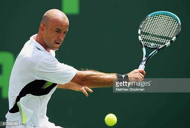 Ivan Ljubicic of Croatia returns a backhand to Roger Federer of Switzerland during the men's final of the Nasdaq-100 Open at the Tennis Center at...