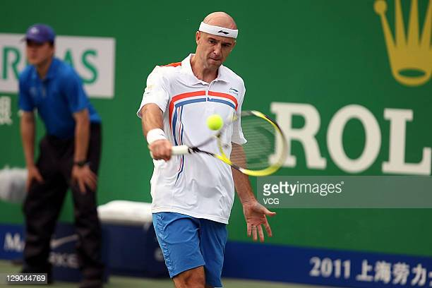 Ivan Ljubicic of Croatia returns a ball to Jurgen Melzer of Austria during day two of the Shanghai Rolex Masters at the Qi Zhong Tennis Center on...