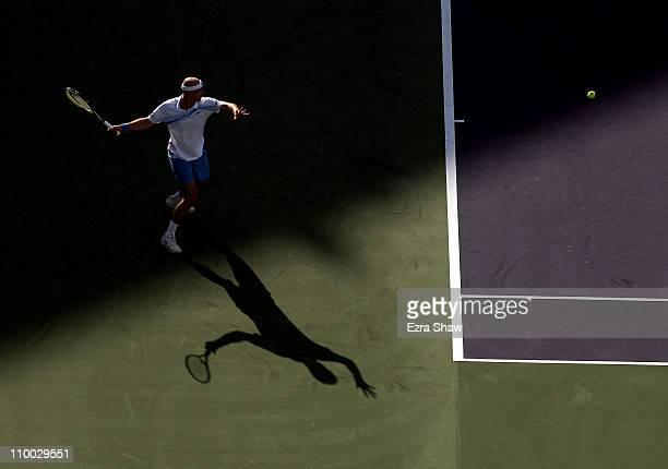 Ivan Ljubicic of Croatia returns a shot to Juan Martin Del Porto of Argentina during the BNP Paribas Open at the Indian Wells Tennis Garden on March...