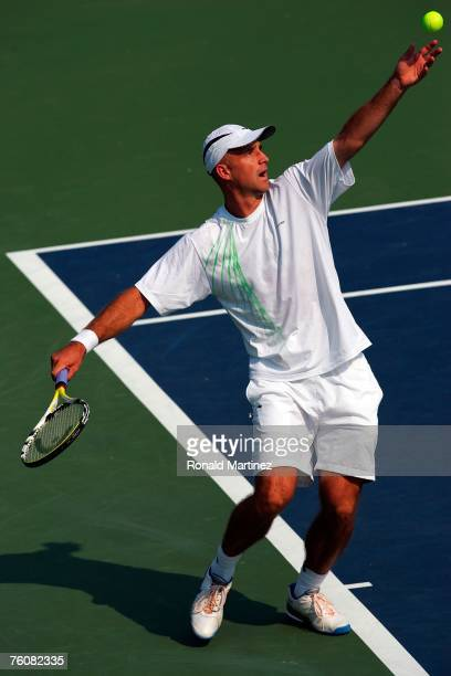 Ivan Ljubicic of Croatia serves to Amer Delic during the Western & Southern Financial Group Masters on August 13, 2007 at Lindner Family Tennis...