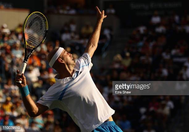 Ivan Ljubicic of Croatia serves to Juan Martin Del Porto of Argentina during the BNP Paribas Open at the Indian Wells Tennis Garden on March 12, 2011...
