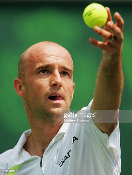 Ivan Ljubicic of Croatia serves to Roger Federer of Switzerland during the men's final of the Nasdaq100 Open at the Tennis Center at Crandon Park on...