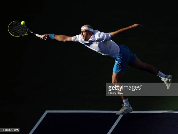Ivan Ljubicic of Croatia stretches for a forehand in his match against Juan Martin Del Potro of Argentina during the BNP Paribas Open at the Indian...