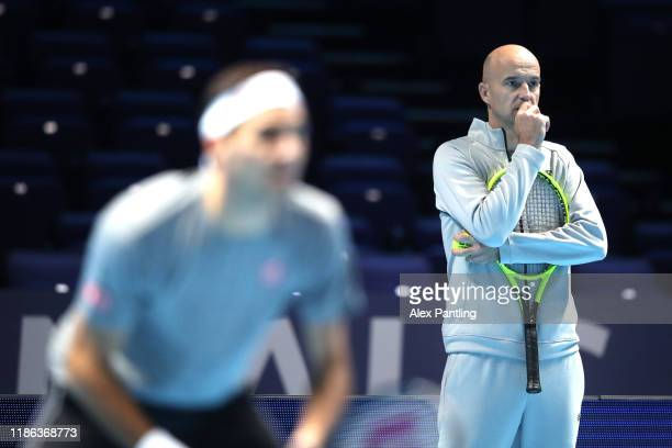 Ivan Ljubicic watches Roger Federer of Switzerland in a practice session during previews for the Nitto ATP Finals at The O2 Arena on November 08,...