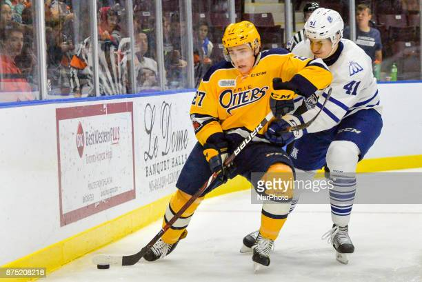 Ivan Lodnia of the Erie Otters takes the draw against Nicolas Hague of the Mississauga Steelheads during OHL game action on November 15 2017 at...