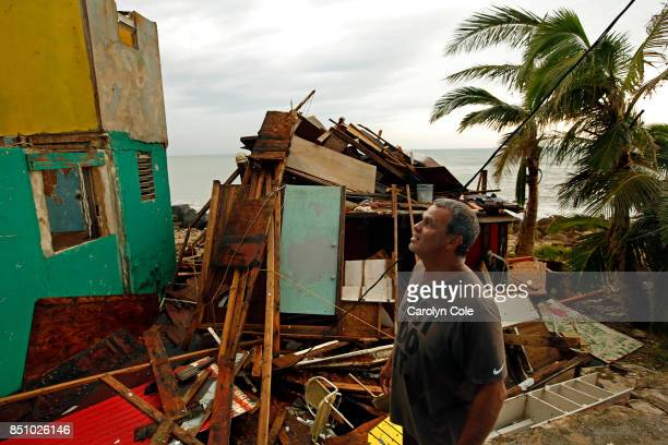 Ivan Lopez, age 51, looks at the damage to his neighbors homes. His home was not as badly damaged so he plans to stay despite the lack of water and...