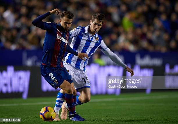 Ivan Lopez of Levante competes for the ball with Aritz Elustondo of Real Sociedad during the La Liga match between Levante UD and Real Sociedad at...