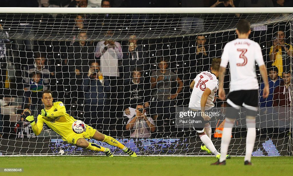 Ivan Lucic of Bristol City saves a penalty from Cauley Woodrow of Fulham during the EFL Cup Third Round match between Fulham and Bristol City at Craven Cottage on September 21, 2016 in London, England.