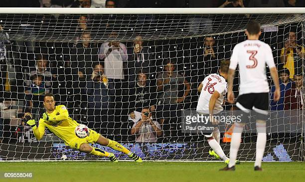 Ivan Lucic of Bristol City saves a penalty from Cauley Woodrow of Fulham during the EFL Cup Third Round match between Fulham and Bristol City at...