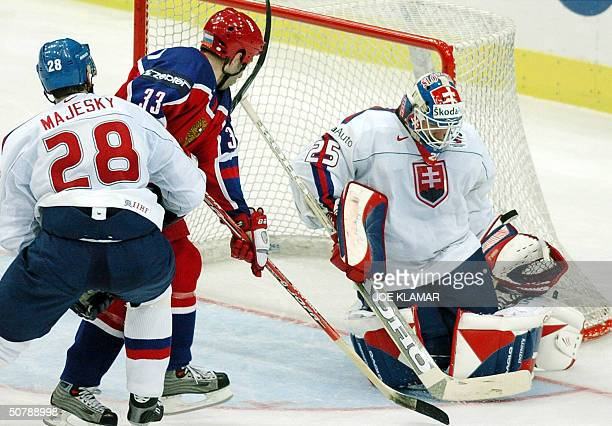 Ivan Majesky of SLovakia tries to stop Alexander Ovechkin of Russia by Jan Lasak's goal during the group F qualifing match in Ice Hockey World...