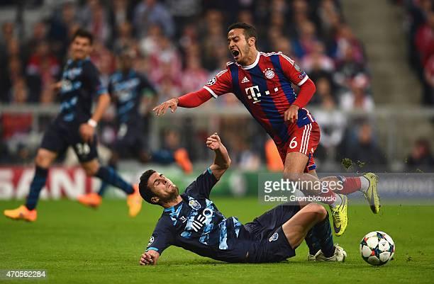 Ivan Marcano of FC Porto slide tackles Thiago Alcantara of Bayern Muenchen during the UEFA Champions League Quarter Final Second Leg match between FC...