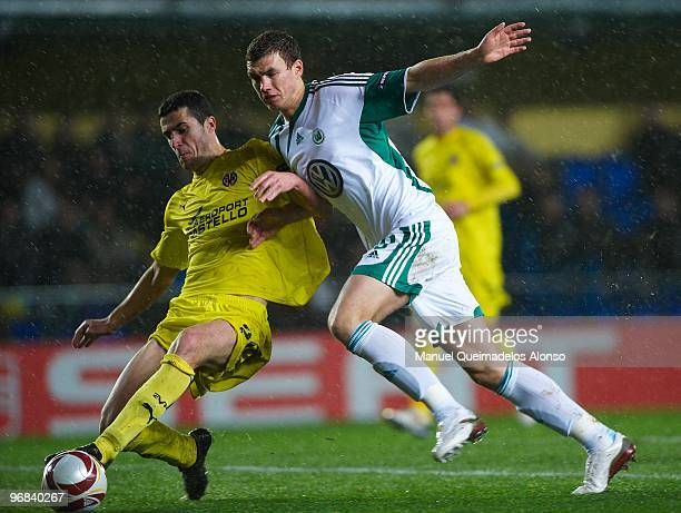 Ivan Marcano of Villarreal competes for the ball with Edin Dzeko of Wolfsburg during the UEFA Europa League football match between Villarreal CF and...