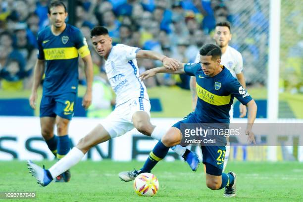 Ivan Marcone of Boca Juniors fights for the ball with Fernando Nuñez of Godoy Cruz during a match between Boca Juniors and Godoy Cruz as part of...