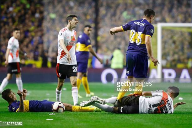 Ivan Marcone of Boca Juniors steps on Exequiel Palacios of River Plate during the Semifinal second leg match between Boca Juniors and River Plate as...