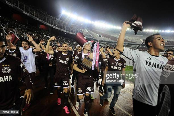 Ivan Marcone of Lanus celebrates with the trophy after a final match between San Lorenzo and Lanus as part of Torneo Transicion 2016 at Monumental...