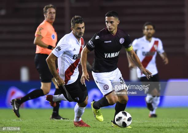 Ivan Marcone of Lanus fights for ball with Lucas Pratto of River Plate during a match between Lanus and River Plate as part of the Superliga 2017/18...
