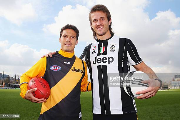 Ivan Maric of the Tigers a soccer fanatic gets to meet Hernanes of Juventus during a Richmond Tigers AFL and Juventus FC media opportunity at Punt...