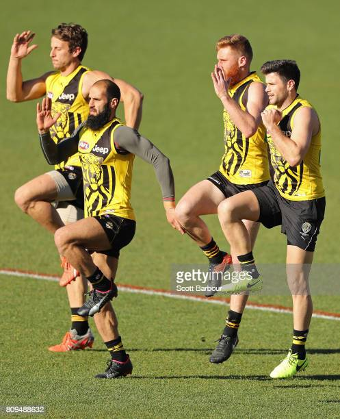 Ivan Maric of the Tigers, Bachar Houli of the Tigers, Nick Vlastuin of the Tigers and Trent Cotchin of the Tigers run during a Richmond Tigers AFL...