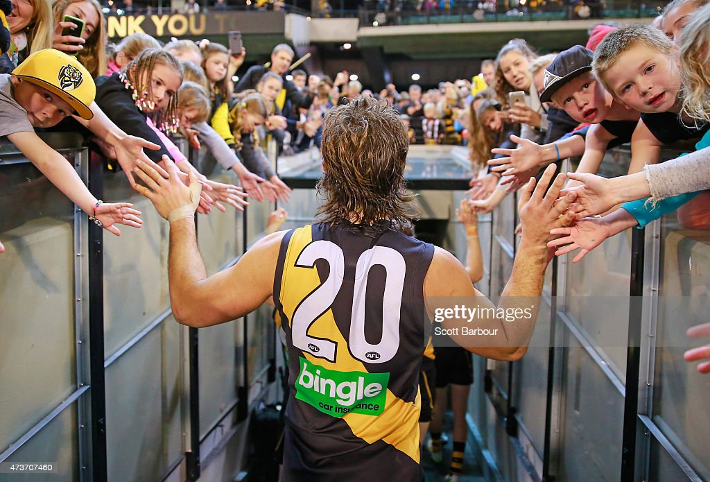 Ivan Maric of the Tigers celebrates with supporters in the crowd after winning the round seven AFL match between the Richmond Tigers and the Collingwood Magpies at the Melbourne Cricket Ground on May 17, 2015 in Melbourne, Australia.