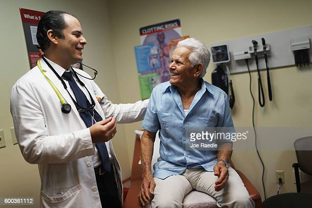Ivan Mendoza MD associate medical director for the Jackson Medical Group's cardiology practice speaks with Felipe Finale during a media event at...