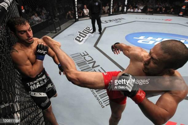 Ivan Menjivar kicks Nick Pace during a bantamweight bout at UFC 133 at Wells Fargo Center on August 6, 2011 in Philadelphia, Pennsylvania.
