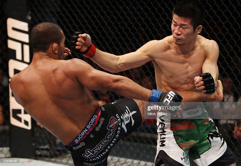 Ivan Menjivar thaws a kick on Hatsu Hioki in their featherweight