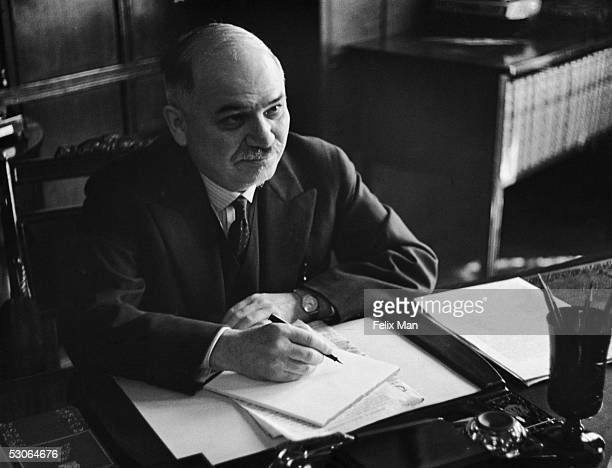 Ivan Mikhailovich Maisky the Soviet Ambassador to Britain at his desk in the Russian Embassy at 13 Kensington Palace Gardens London 12th July 1941...