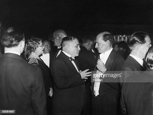 Ivan Mikhailovich Maisky the Soviet Ambassador to Britain in conversation with Clement Attlee leader of the Labour Party at the Holborn Restaurant in...