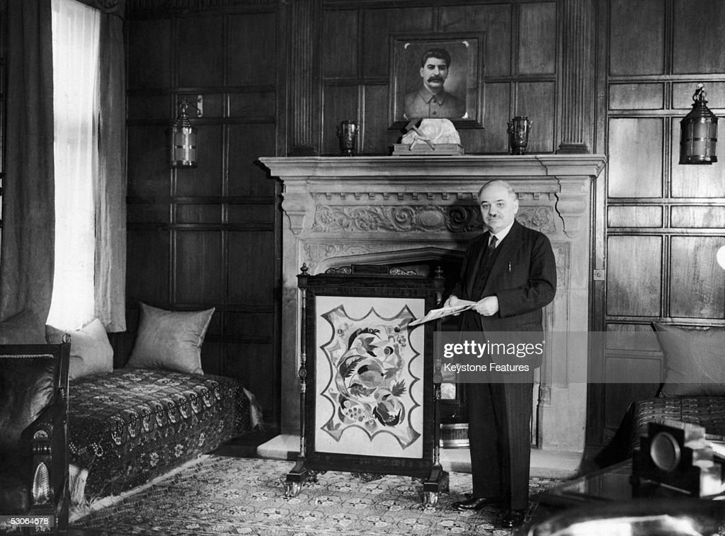 Ivan Mikhailovich Maisky (1884 - 1975), the Soviet Ambassador to Britain, standing by the fireplace of his study at the Russian Embassy in London, 1941. Above the mantelpiece is a stone-carved hammer and sickle, and a portrait of Josef Stalin.