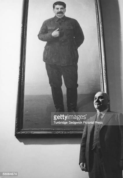 Ivan Mikhailovich Maisky the Soviet Ambassador to Britain stands beneath a large painting of Josef Stalin at the Russian Embassy in London July 1940