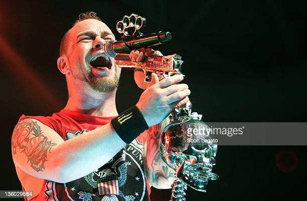 Ivan Moody of Five Finger Death Punch performs at the Compuware Arena on December 16, 2011 in Plymouth, Michigan.