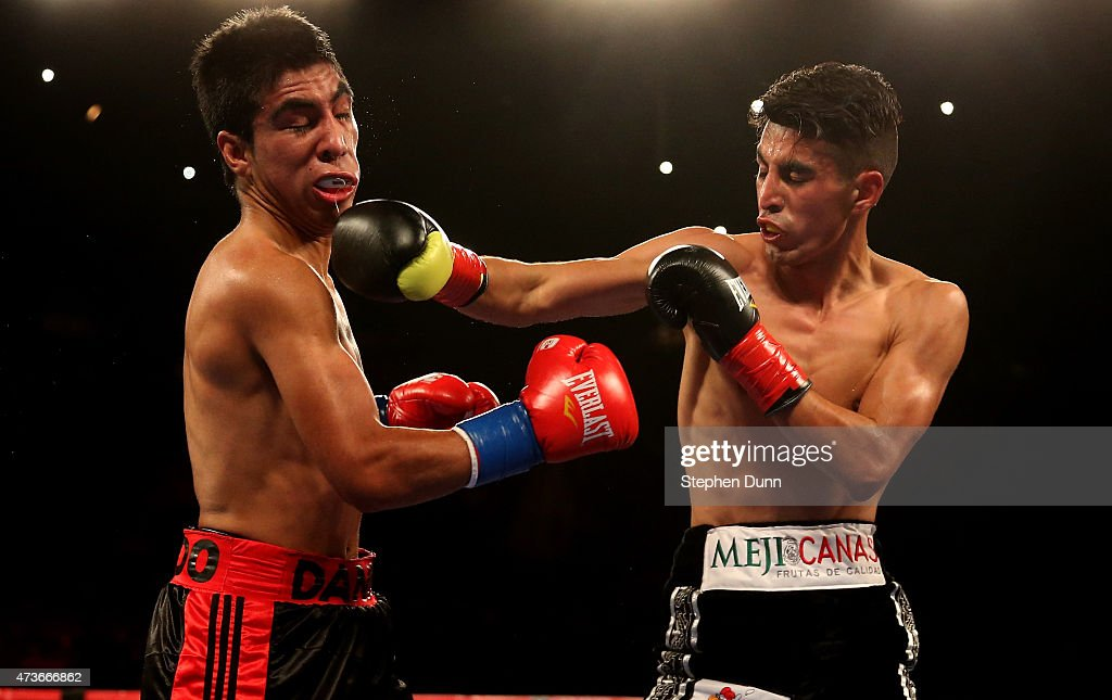 Ivan Morales (R) lands a punch on Danny Flores in their Bantamweight fight at The Forum on May 16, 2015 in Inglewood, California. Morales won by TKO in the eighth round.